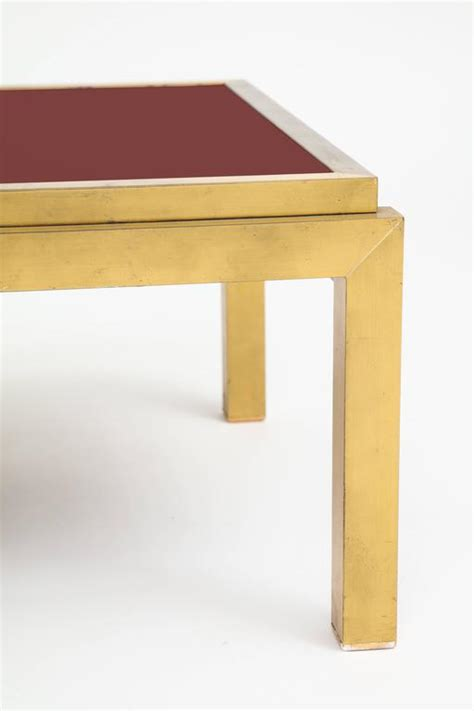 red glass table l maison jansen attributed brass red glass coffee table