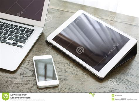 laptop with tablet and smart phone on table