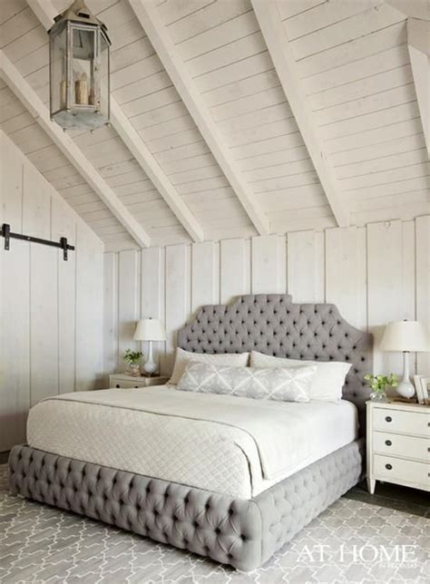 gray tufted bed white plank walls ceiling gray tufted bed lattice rug