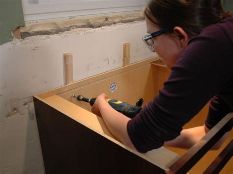 kitchen sink backs up into other side kitchen catch up how to install cabinets how tos diy