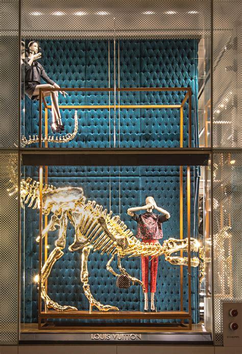 louis vuittons gilded dinosaur skeleton window installation