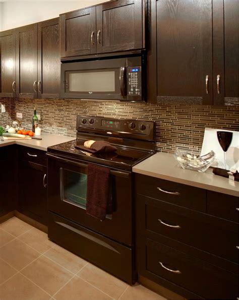 Modern kitchen with glass mosaic backsplash, taupe floor