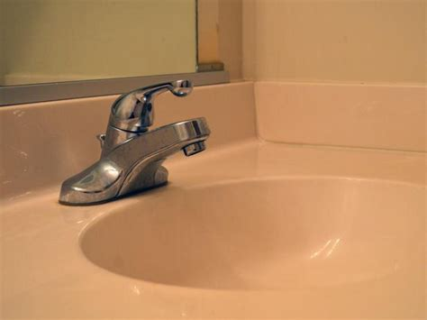 replacing a kitchen sink faucet how to replace a bathroom faucet how tos diy