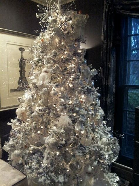 decorated flocked christmas trees fresh flocked christmas tree decorated in white sliver and grey one of my favorites i
