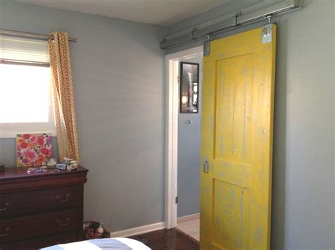 spectacular yellow painted single sliding barn doors for