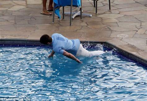 zac efron falls  swimming pool  filming  wedding