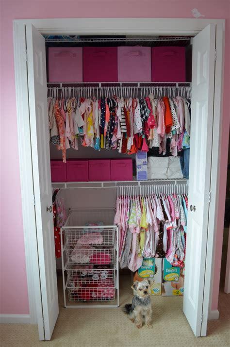 simple bedroom with baby nursery closet organizers white