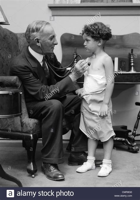 Doctor Doctor Home Doctor 1930s Man Doctor Making House Call Holding Stethoscope To