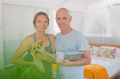 Portrait Mature Couple With Dog And Tablet Stock Image