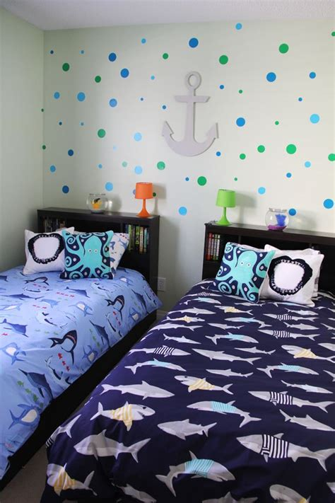 By tucking the beds into a corner, you'll free up plenty of floor space. Boys Shark Theme Shared Bedroom - A Pretty Life In The ...