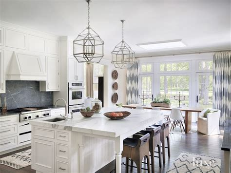 contemporary white kitchen  gold marble island luxe