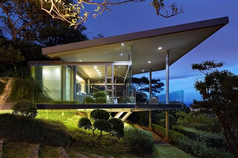 Glass house elevated on top of metallic columns has also 3 ...