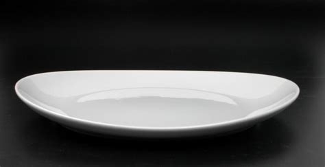 ustensiles de cuisine en fonte assiette à steak ovale en porcelaine la casserolerie