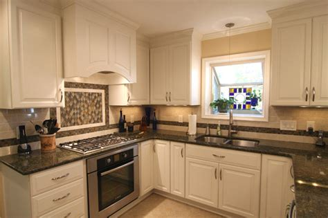 white kitchen cabinets with dark countertops dark brown granite countertops with white cabinets www