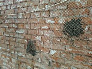 Retrofit Of Wall Using Wire Mesh And Cement Grouting