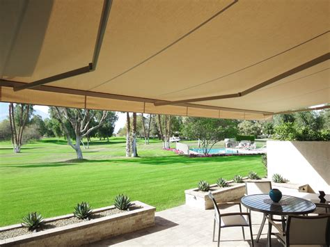 Backyard Awning by Retractable Awnings Above All Awnings