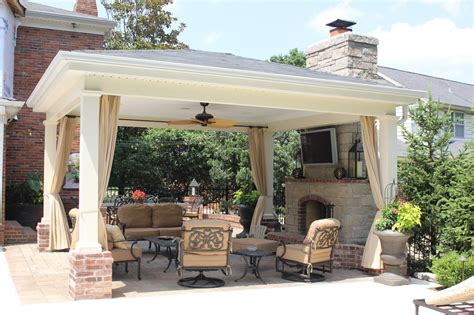 covered patio fireplace with pool poynter landscape