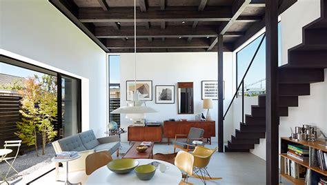 takatina completes elevated black box house  suburban japan