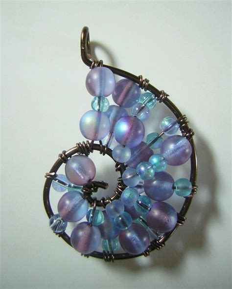 blue  purple wire wrapped seashell pendant