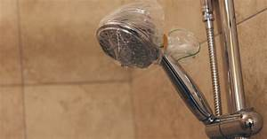 Vinegar clean showerhow to clean your showerhead with for How to clean bathroom with vinegar