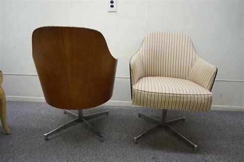 four milo baughman style teak back swivel dining chairs