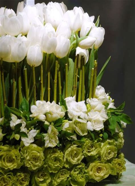 white flower table l white and green arrangement pretty tulips and roses