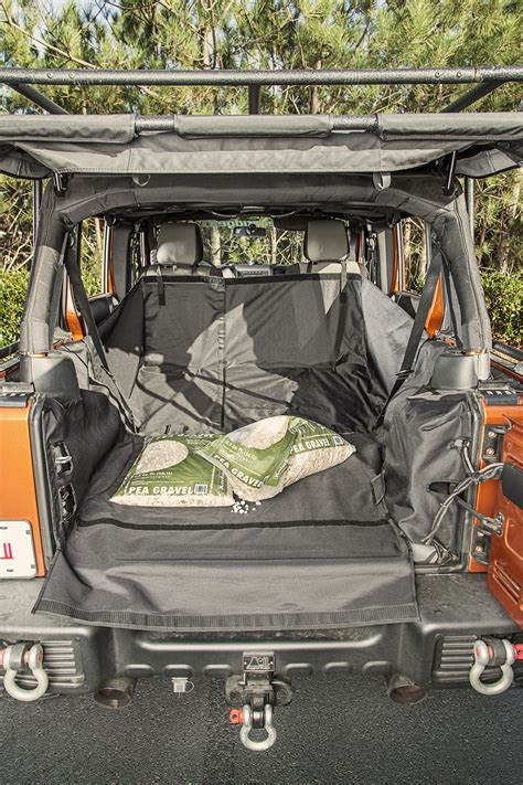 rugged ridge   cargo cover  subwoofer