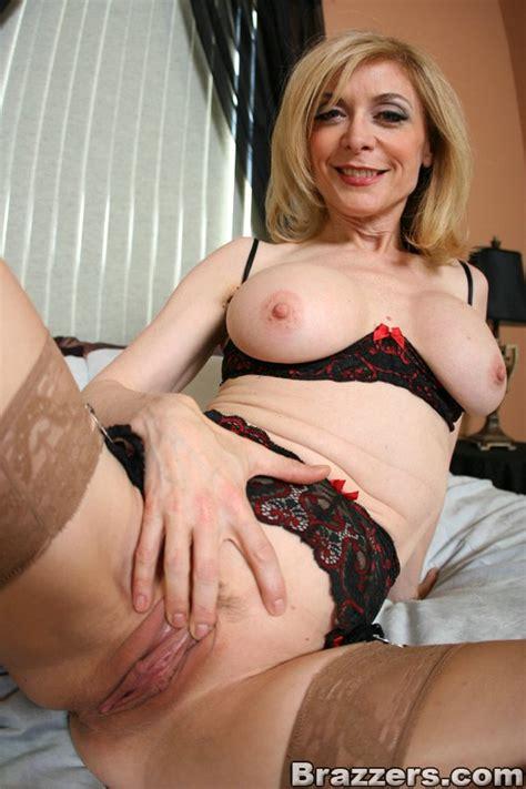 Slutty Mom Nina Hartley Posing In Lace Lingerie And Nylon