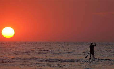 Paddle board at sunset in Tamarindo with a photographer   Board