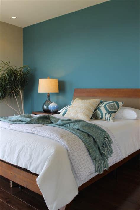 teal blue wall ikat pillows seeded glass lamps modern