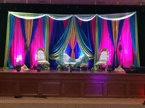 mehndi stage in royal blue hot pink green gold sweet