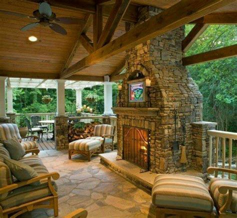 covered patio with rock fireplace rock