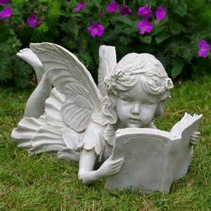 laying reading a book garden ornaments statues