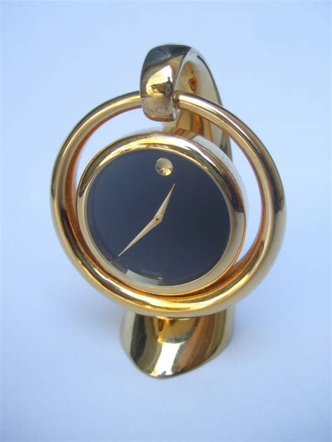 movado sleek gilt metal diminutive desk clock at 1stdibs