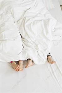 Sisters, Feet, Sticking, Out, Of, Duvet, On, Bed, -, Stock, Image, -, F010, 9782