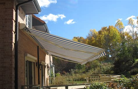 bright awning  mediterranean style house rolltec retractable awnings toronto ontario