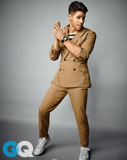 nick jonas suits up for gq s february issue shine on media