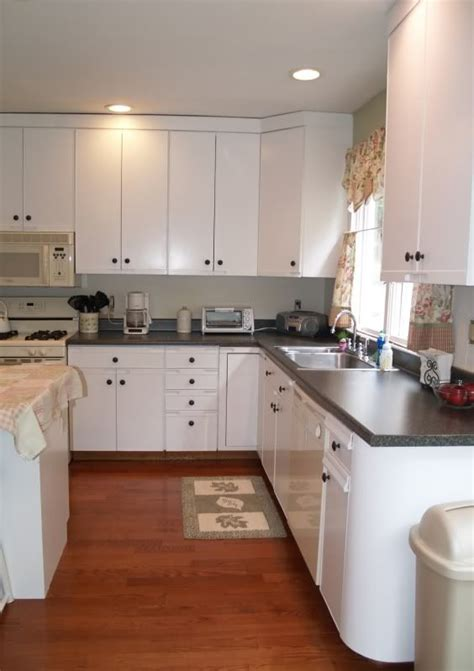 best paint for laminate kitchen cabinets 17 best ideas about laminate cabinets on 9176