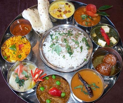 cuisine hindou thali a large plate with various indian food with