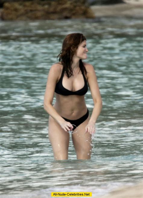 Stephanie Seymour nipple slip in black bikini paparazzi shots