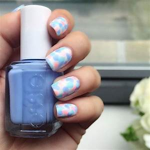 Get festive with this pastel blue pink and green nail art