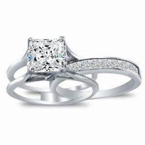 the wedding band slides inside the engagement ring With engagement ring fits inside wedding band