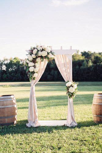 rustic wedding decor white wooden arch decorated