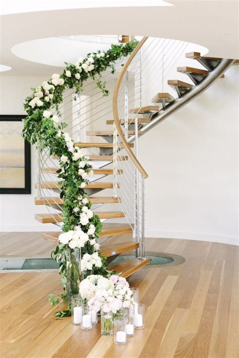 staircase garland and flowers decorating staircases