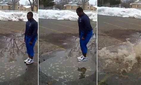 teenager jumps   puddle    bet  ends