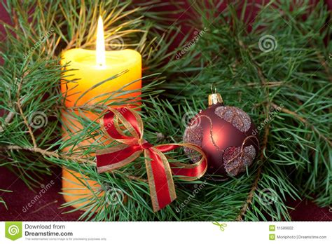 big christmas baubles and candles on dark stock