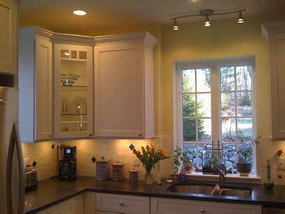 kitchen with small track lighting bar above sink   Kitchen