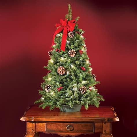 the freshly cut prelit tabletop tree hammacher schlemmer