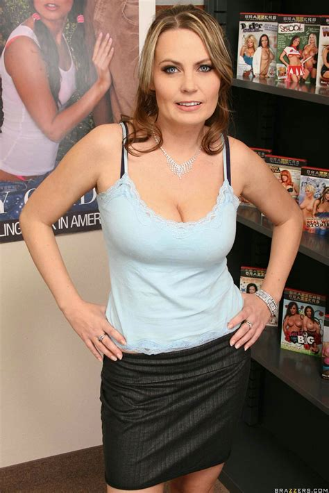 Alexis May enjoying sex with muscular guy in the video store - My Pornstar Book