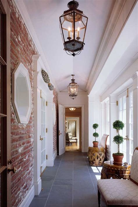 breezeway lantern light fixture and exposed brick on